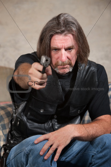 Man in Biker Gang Vest with Gun