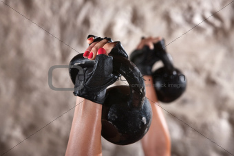 Female Hands Lifting Weights
