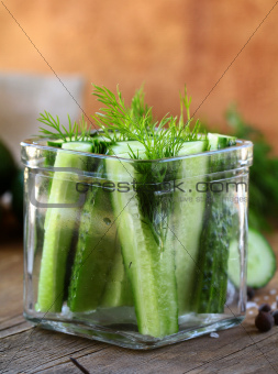cucumbers in the jar with dill salt and pepper
