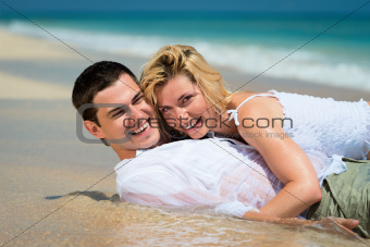 Happy young couple on tropical sands