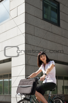 woman riding bicycle and going to work