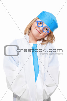 boy with long blond hair playing a doctor smiling