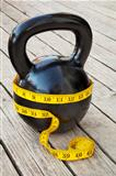 kettlebell and measuring tape