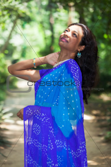 young indian woman in a saree outdoors 