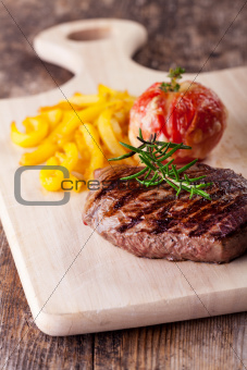 grilled steak with fries and tomato