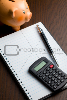 calculator and blank notebook
