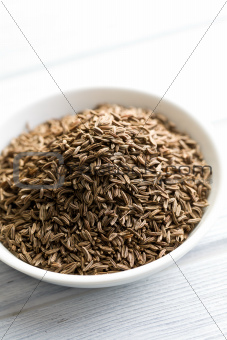 cumin seeds in ceramic bowl