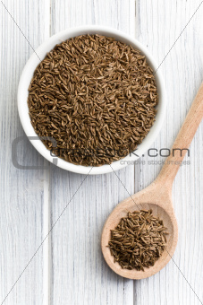 cumin seeds in wooden spoon