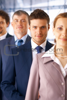 Closeup of Businessman With Colleagues.
