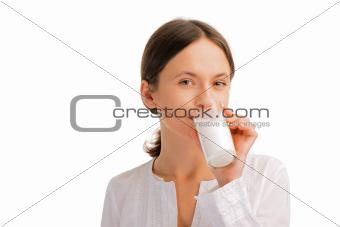 Portrait of woman drinking milk