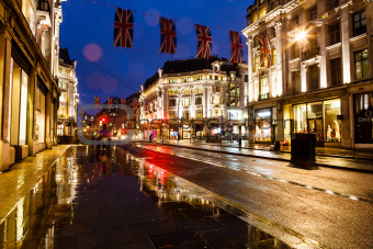 Illuminated Rainy Street in London at Night, United Kingdom