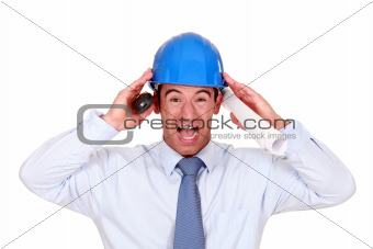 businessman with a helmet having a headache