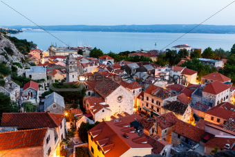Aerial View on Illuminated Town of Omis in the Evening, Croatia