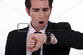 businessman in a hurry looking at his watch