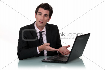 Man demonstrating a laptop