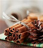 Cinnamon sticks and cone on tea towel
