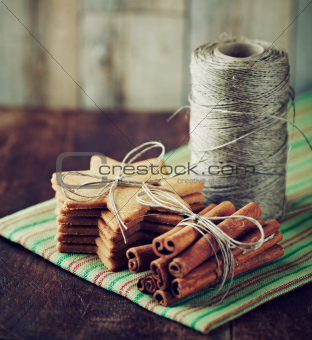 Gingerbread cookies, cinnamon and kitchen twine