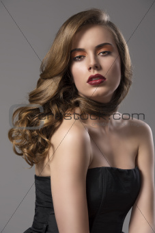 pretty girl with wavy hair on shoulder and sensual expression