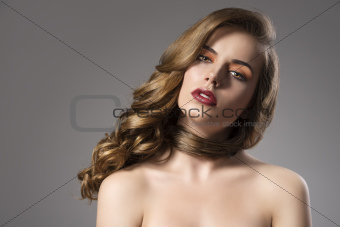 pretty girl with wavy hair on shoulder and folded head