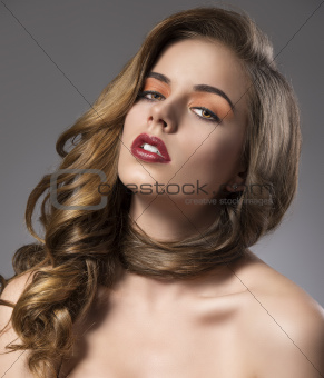 pretty girl with wavy hair on shoulder turned at right