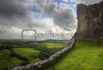 Ruined medieval castle landscape with dramatic sky