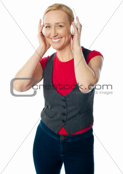 Aged female enjoying music on her music player