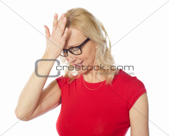Frustrated woman holding her head