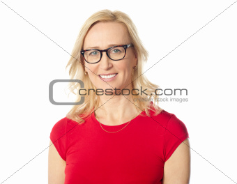 Smiling aged beautiful lady posing with eyewear