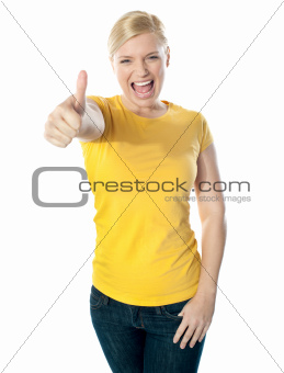 Smiling gorgeous girl showing thumbs-up