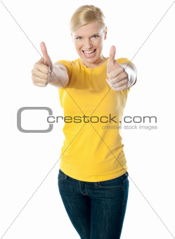 Happy young woman showing double thumbs-up