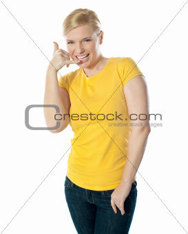 Attractive girl showing calling gesture