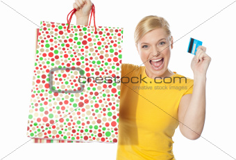Beautiful girl posing with shopping paper bag