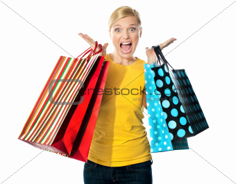 Young woman excited after tons of shopping