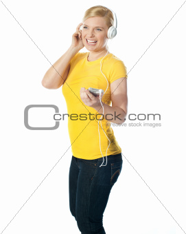 Pretty woman holding music player