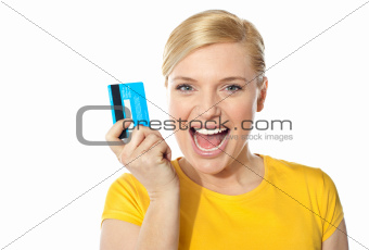 Blond sales girl posing with credit card