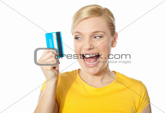 Smiling young girl holding debit-card