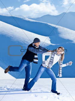 Happy couple having fun in snow