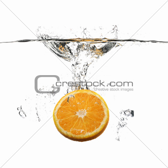 orange with water splash on white