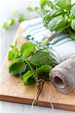 Fresh herbs on wooden kitchen board
