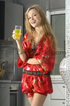 blond in modern kitchen with juice