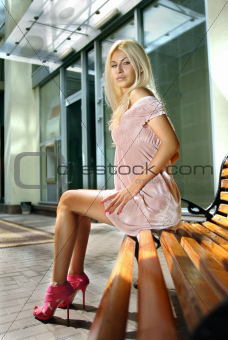 blond woman on bench