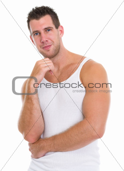 Portrait of happy muscular man in a-shirt