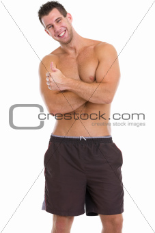 Happy male athlete showing thumbs up