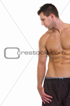 Strong athletic man looking on copy space
