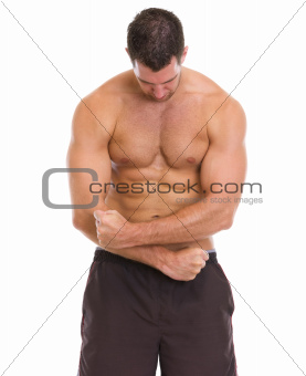 Muscular man showing muscles