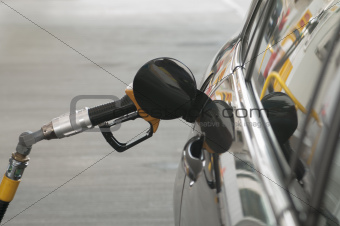 Fuelling car in gas station