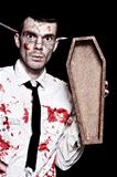 Dead Zombie Business Man Holding Funeral Coffin