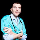 Handsome Male Doctor Standing Confidently On Black
