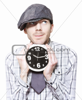 Young School Boy Watching Time While Holding Clock