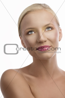 portrait of blonde girl with colored make-up, she looks up
